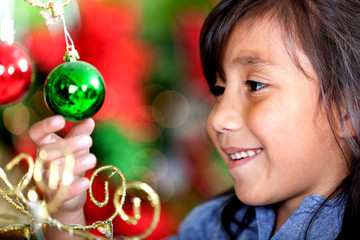 Girl holding Christmas ball