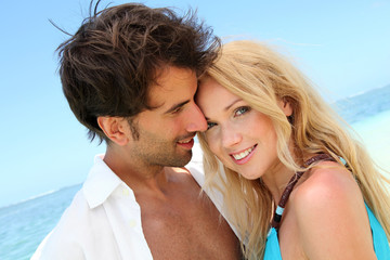 Portrait of in loved couple on beach holidays