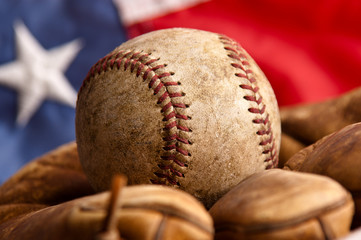 Vintage baseball glove and ball with American flag