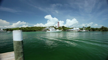 Tropical Island Lighthouse with Passing Yachts
