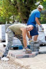 man at work paving stones
