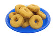 Doughnuts stacked on blue plate
