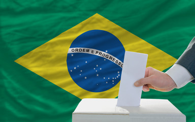 man voting on elections in brazil