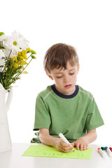 Little boy writing a thank you note