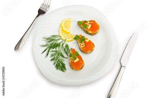 Red caviar served on bread