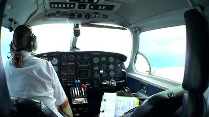 Pilot in Cockpit of Light Aircraft