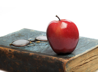 book & red apple