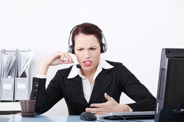 Beautiful business woman shouting through the headphones.