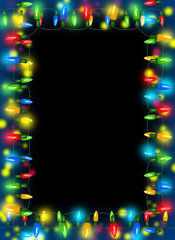 Frame of Christmas lights on dark background