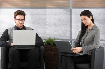 Young businesspeople using laptop