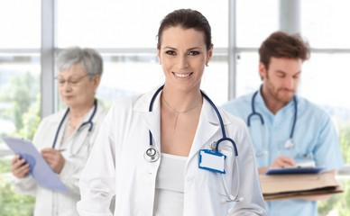 Medical team female doctor in front