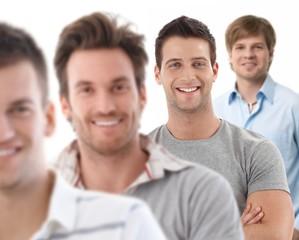Group portrait of happy young men