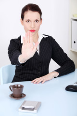 Businesswoman showing stop gesture.