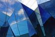 Leinwandbild Motiv Modern building with sky reflection