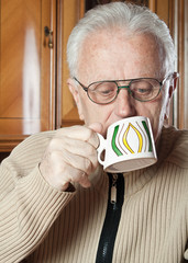 elderly man drinks tea