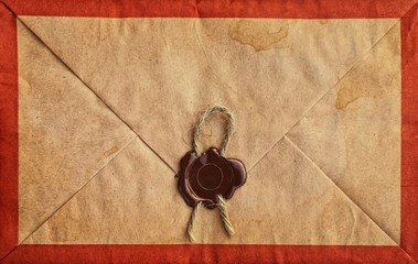 Old grunge envelope with sealing wax and rope.