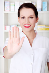 Pharmacist showing stop gesture.