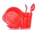 Bright red plastic tableware  isolated on white