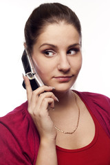 Young woman talking by mobile