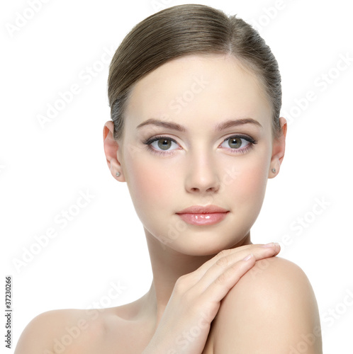 Face of beautiful girl with clean skin - isolated on white