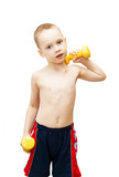 The little boy goes in for sports with dumbbells