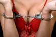 young woman in red lingerie handcuffed