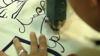 Expert seamstress weaves a written