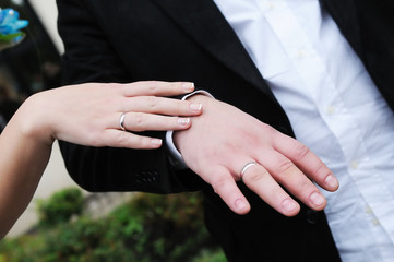 Bride's and groom's hands with wedding rings
