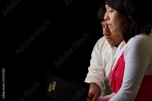Hispanic Couple Studying the Bible