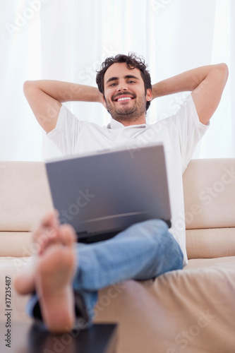 Portrait of a young man using a laptop