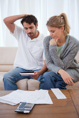 Portrait of a couple looking at their bills