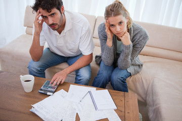 Worried couple doing their accounting