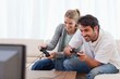 Cheerful couple playing video games