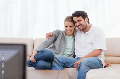Happy couple watching TV