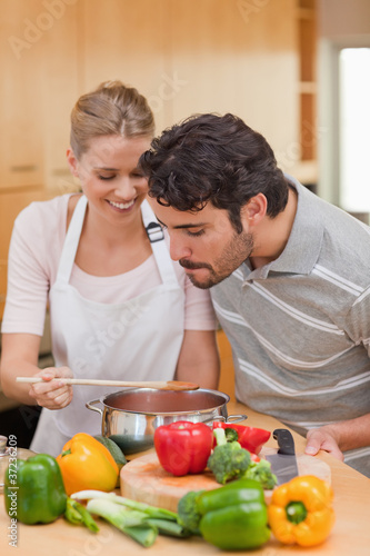 Portrait of a happy couple preparing a sauce