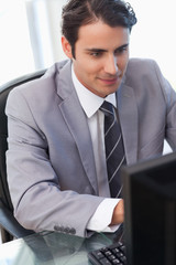 Portrait of a young businessman working with a computer