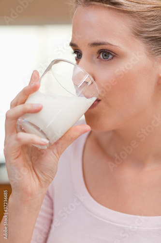 Portrait of a woman drinking a glass of milk