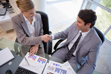 Business people agreeing on a deal