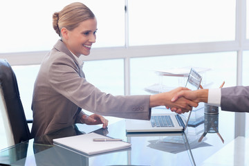 Young businesswoman receiving a customer