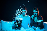 Love couple in 3D glasses at home