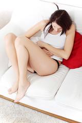 Beautiful woman having a stomach ache.