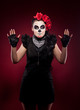 funny woman in day of the dead mask smile on red