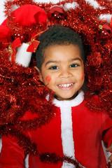 mulatto child Santa on a White background