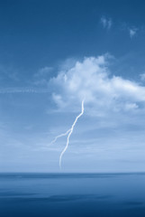 lightning in a clear sky over the ocean