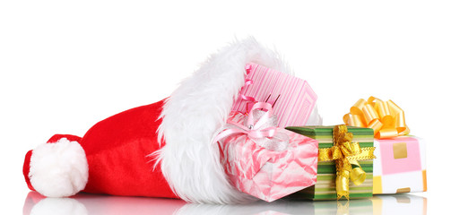 Beautiful Christmas hat and gifts isolated on white