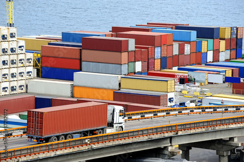 truck transports container to warehouse near the sea