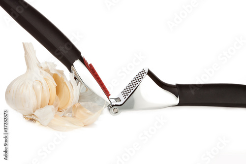 garlic press, bulb and cloves