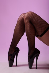 Sexy female legs in black fishnet stockings and fetish ballet sh
