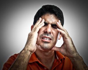 Very stressed hispanic man with a headache