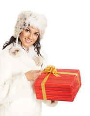 Young and beautiful woman holding a Christmas present